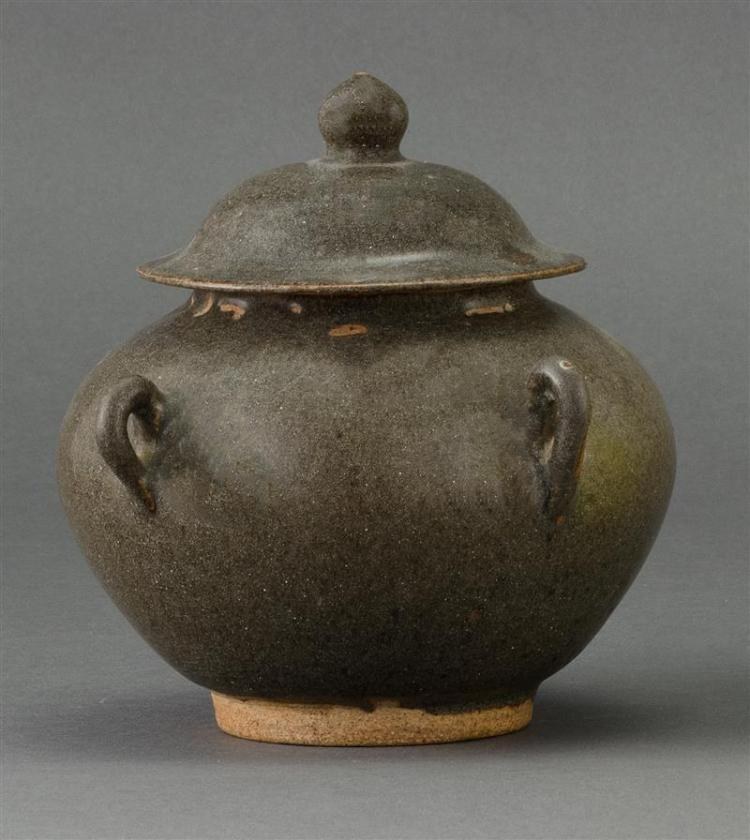 TEADUST GLAZE COVERED JAR After a Song example. In ovoid form with four loop handles. Domed cover with onion finial. Height 5.5