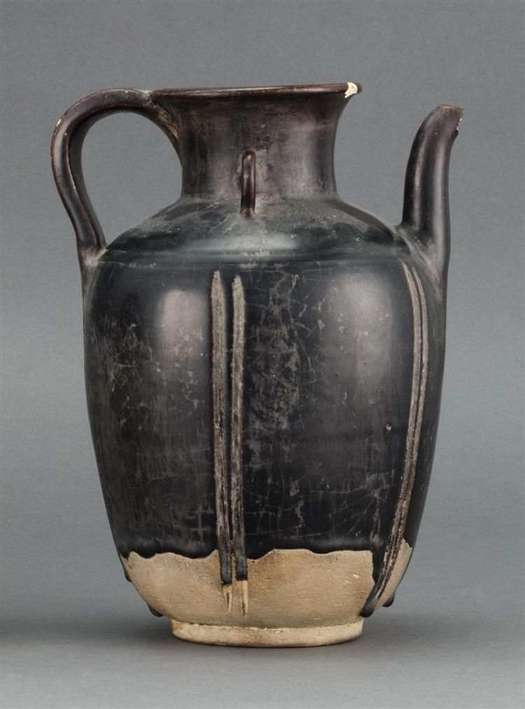 BLACK-BROWN GLAZE POTTERY EWER In five-lobed form with strap handle. Height 8.75
