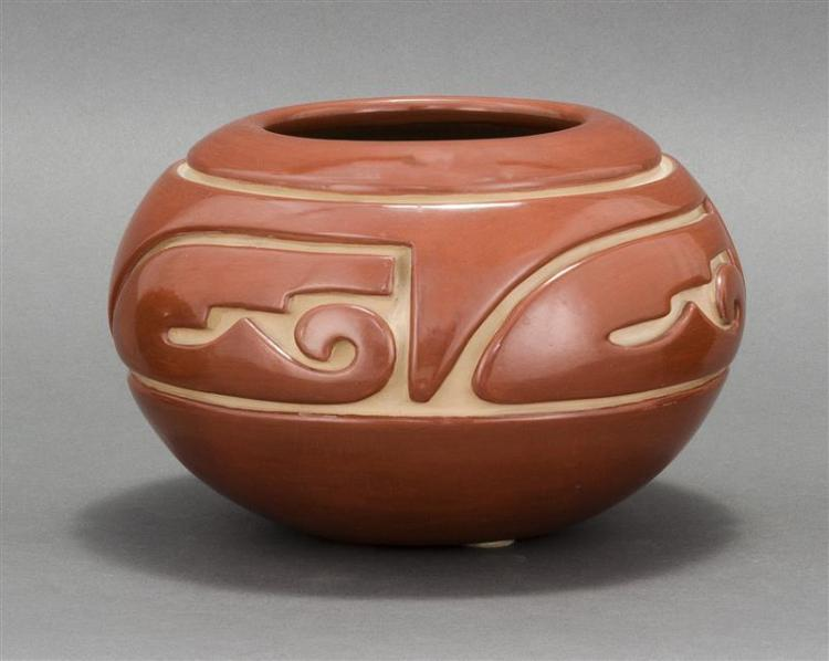 SANTA CLARA PUEBLO POTTERY JAR By Jennie Trammel (1929-2010) . Red on white in a stylized wing design. Diameter 9.25