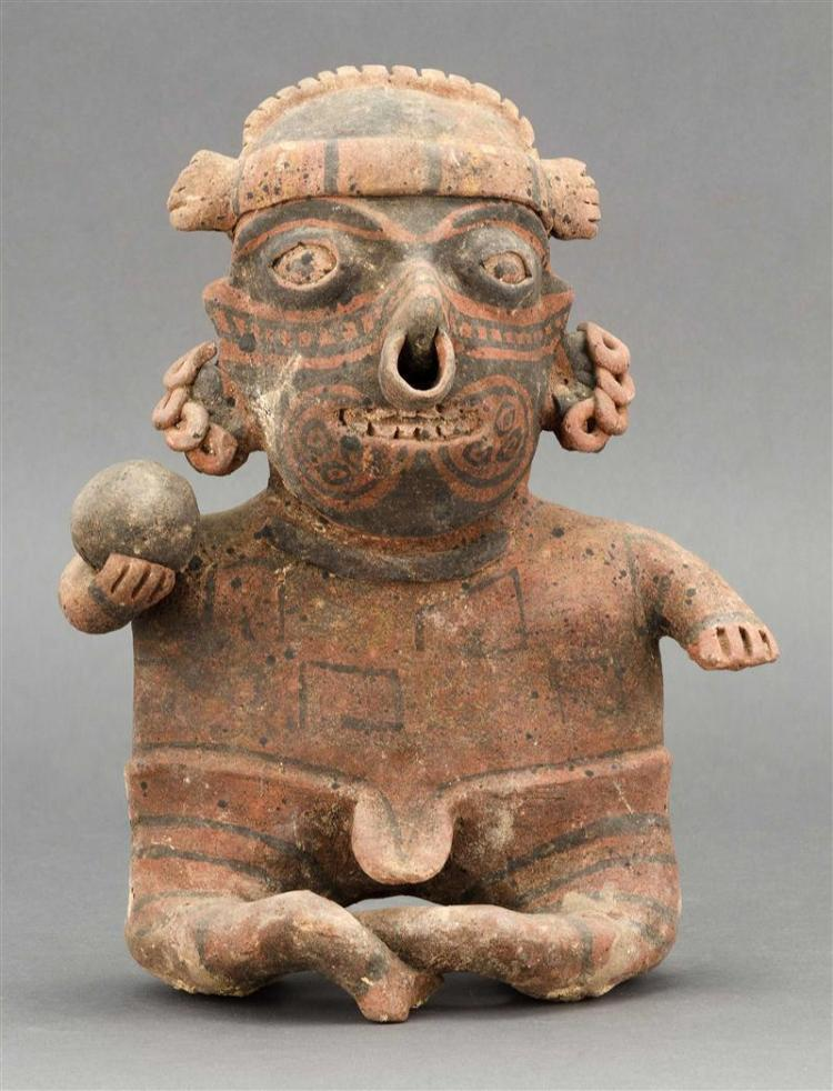 NAYARIT FIGURE In the form of a seated man holding a ball. Height 11