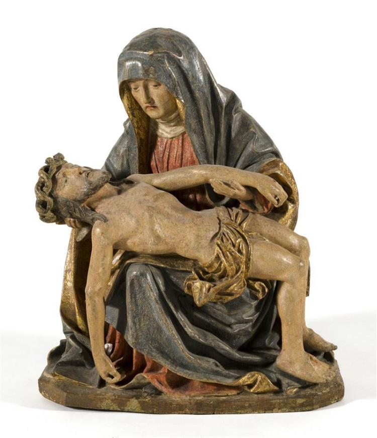 CARVED POLYCHROME WOOD PIETÀ Depicting The Virgin Mary holding the crucified Christ. Height 24