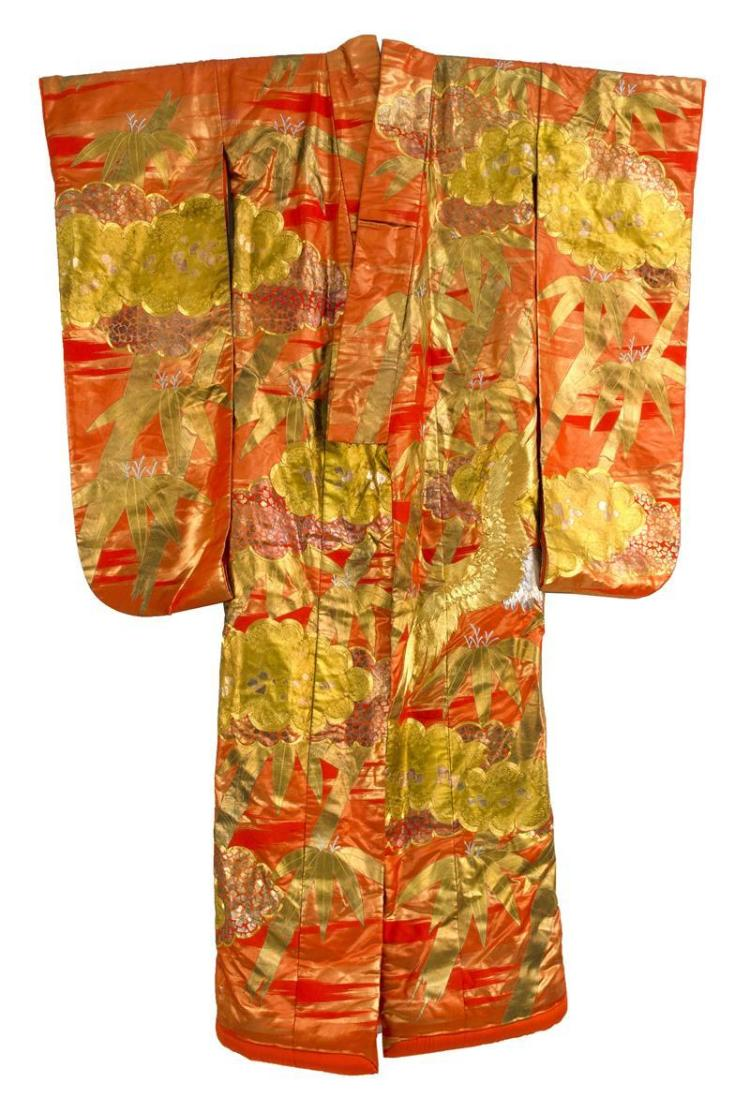 WEDDING KIMONO With gold and silver crane and bamboo needlework on an orange ground.