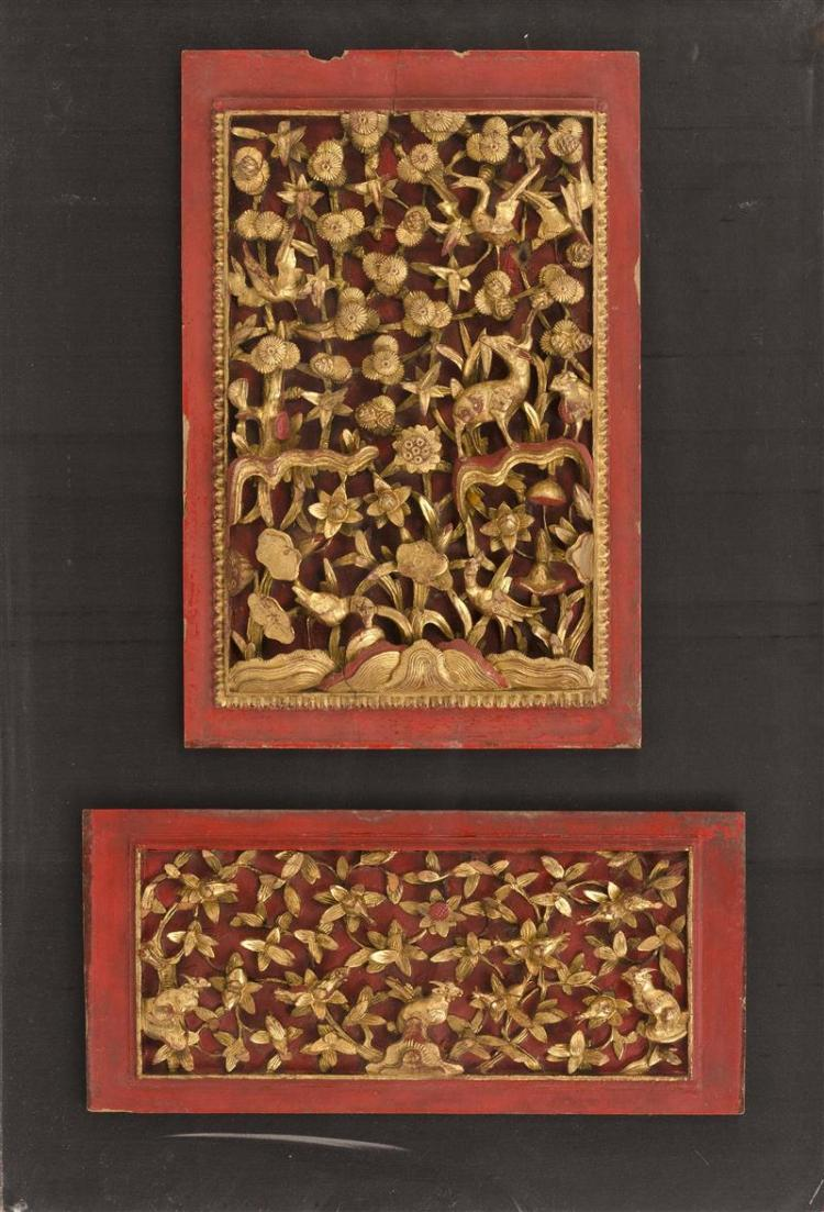 TWO CARVED GILTWOOD PANELS One depicting deer and pine trees, 16