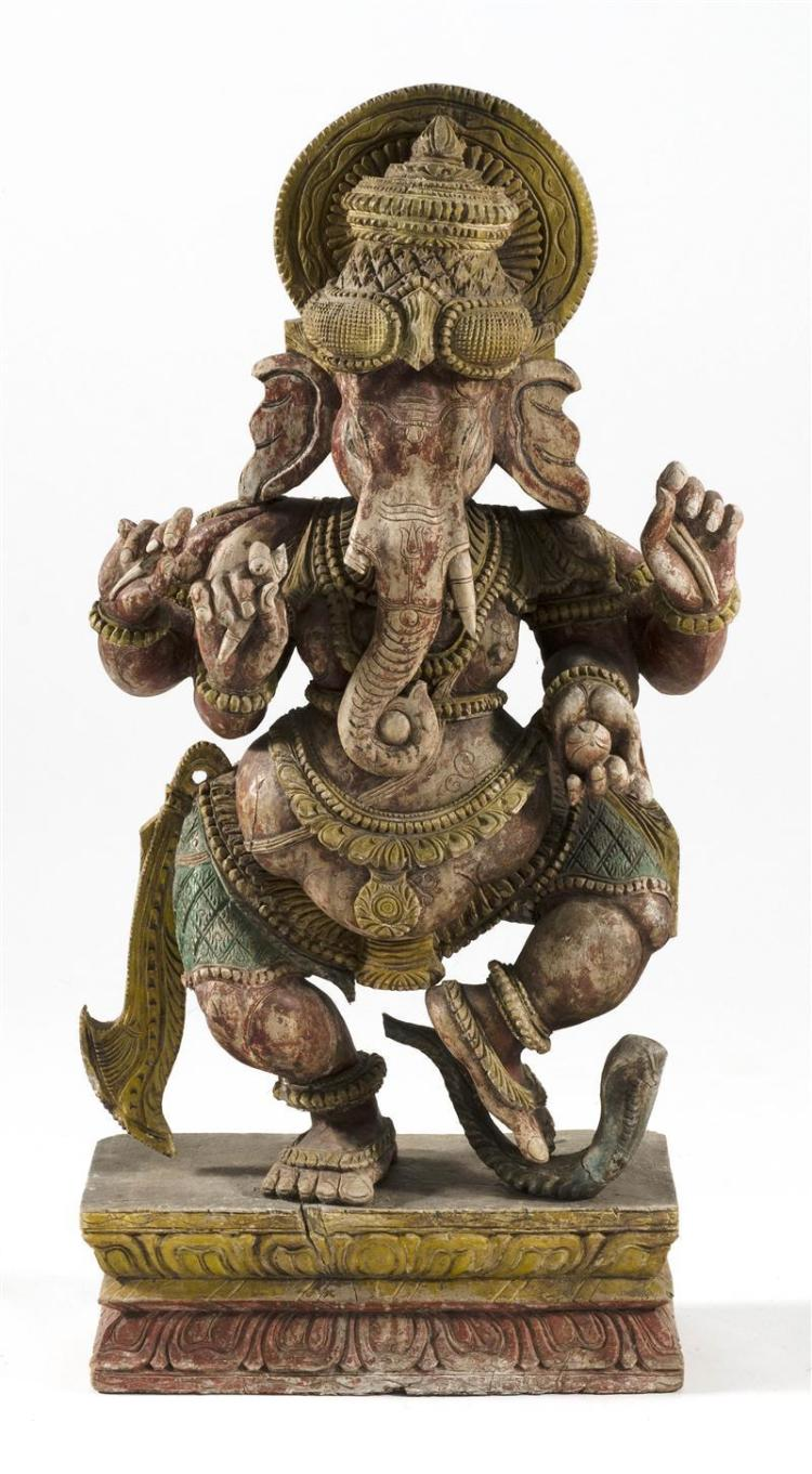 CARVED POLYCHROME WOOD FIGURE OF GANESHA Depicted with four arms, dancing on a snake. Height 40