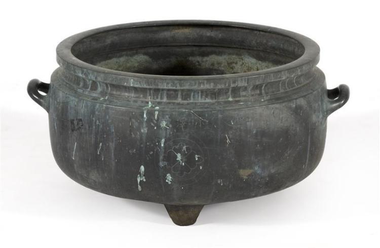 BRONZE HIBACHI In ovoid form with two handles and floral mon design. Inscribed by Sadakazu. Diameter 20