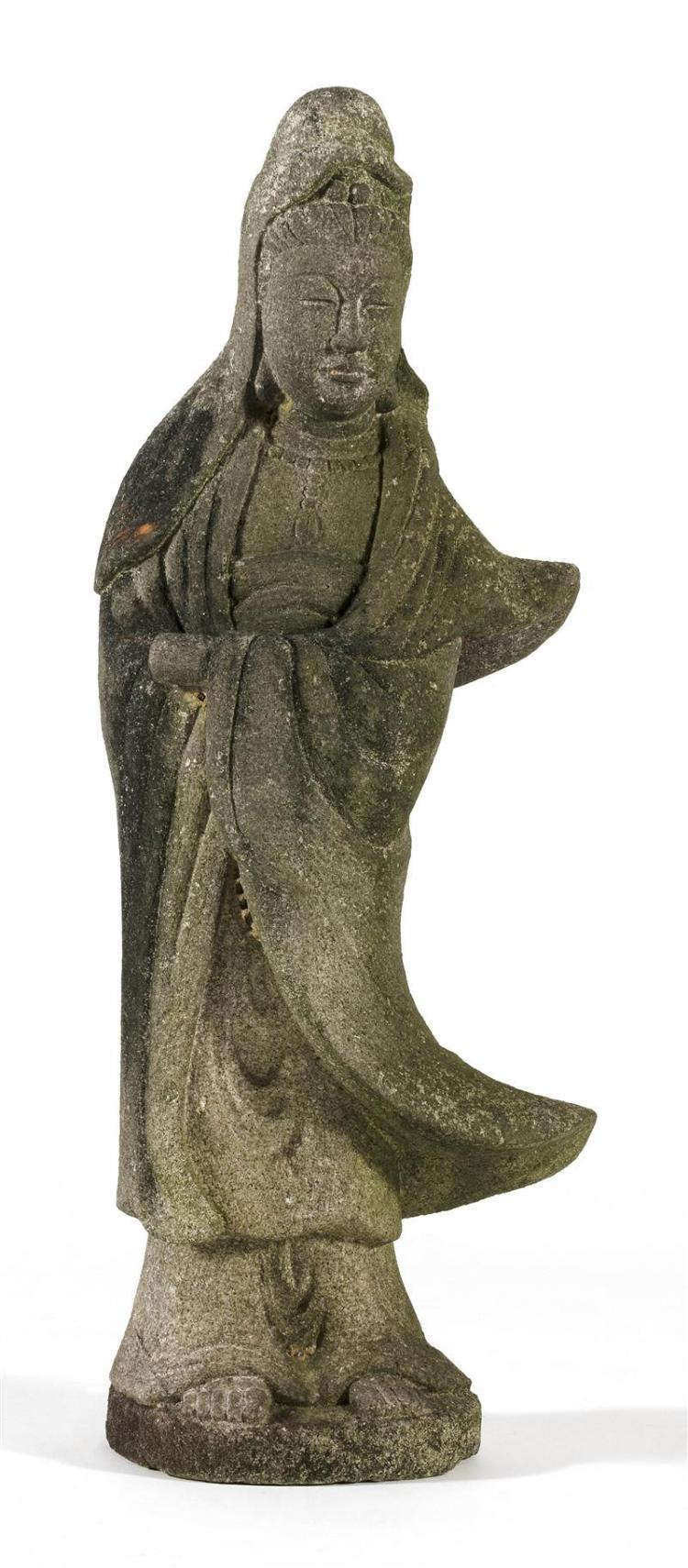 CARVED GRANITE FIGURE OF KWANNON Standing while holding a rolled scroll. Height 44.5