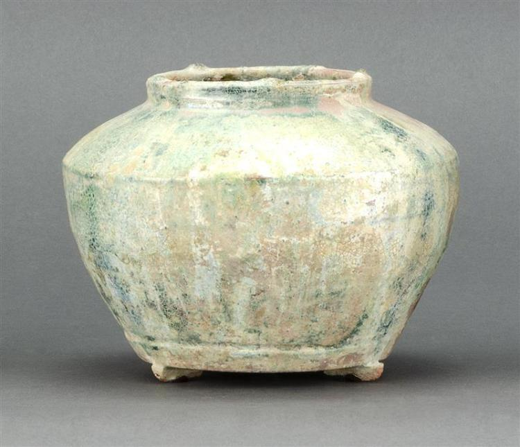 IRIDESCENT GLAZE POTTERY JAR In ovoid form with a varied green glaze. Height 4.2