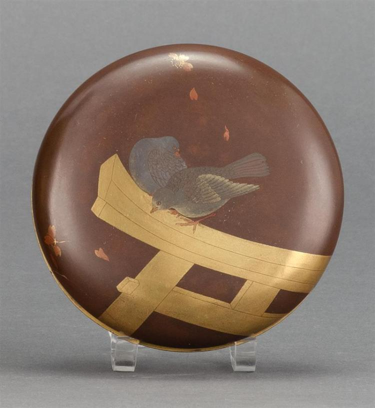 GOLD AND BROWN LACQUER BOX In circular form with a dove and torii (gate) design. Nashiji interior. Diameter 3.75