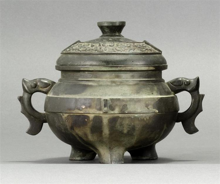 BRONZE CENSER In ovoid form with animalistic handles and domed cover. Relief stylized dragon design. Height 5.5