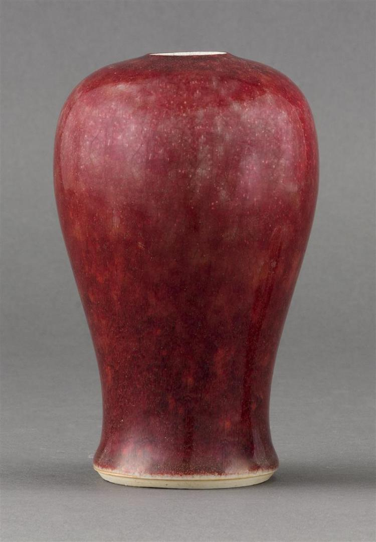 SANG DE BOEUF PORCELAIN VASE In meiping form. Height 6.25
