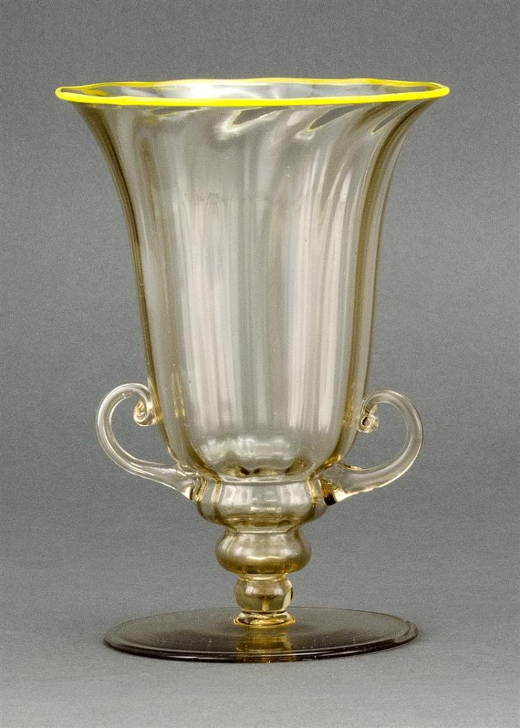VENETIAN GLASS VASE In amber tint with yellow rim, circular foot, and scrolled handles. Height 7