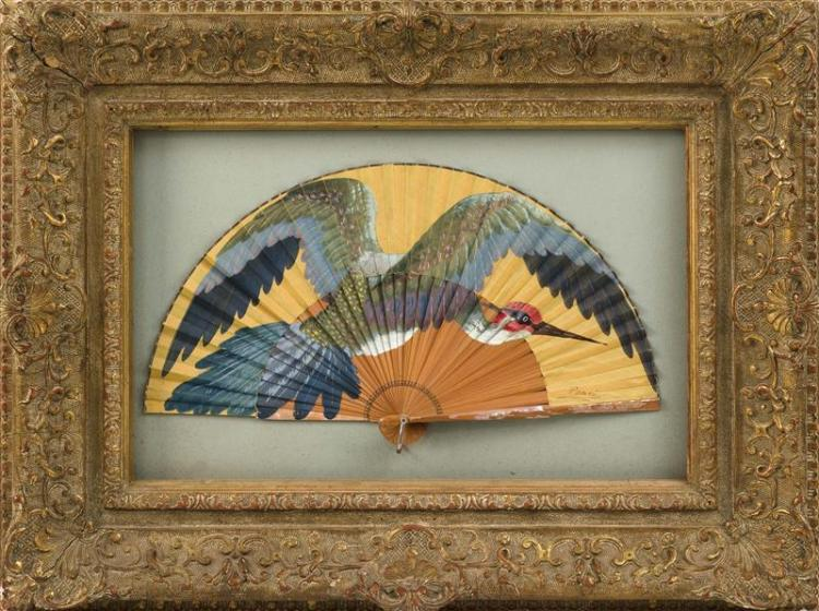 PAINTED WOOD AND PAPER FOLDING FAN Depicting an exotic bird in flight. Signed