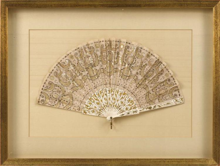BONE AND SEQUINED FOLDING FAN In stylized floral design. Length 16.75