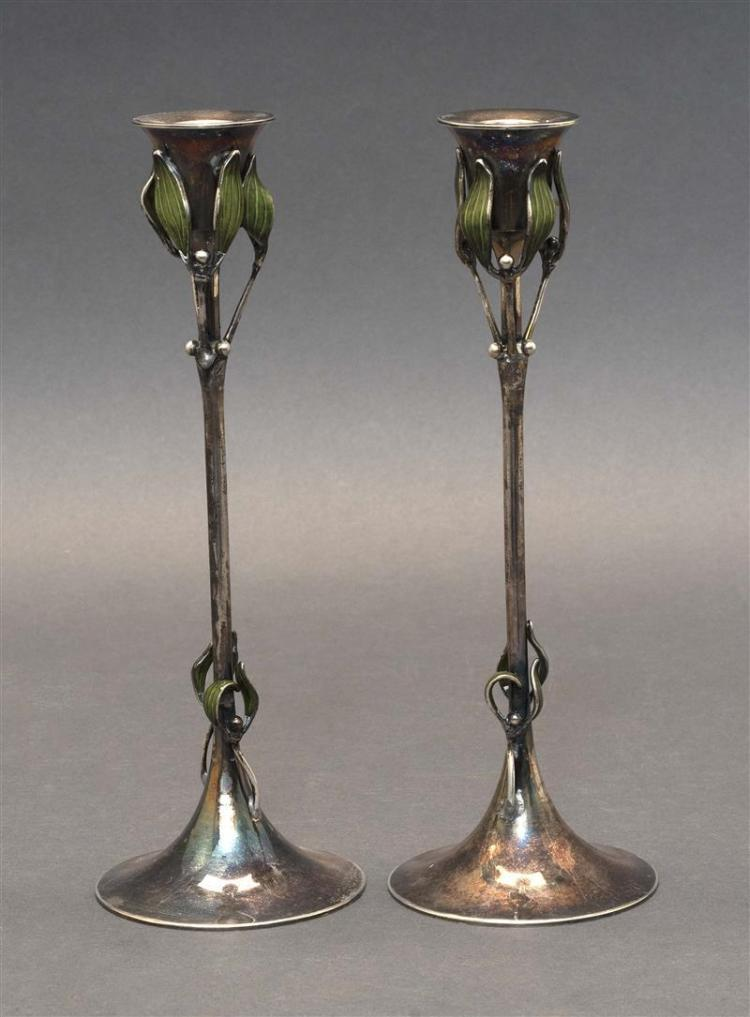 PAIR OF GEORG ADAM SCHEID JUGENDSTIL .900 SILVER AND ENAMEL CANDLESTICKS Both stems adorned with green leaves and silver buds. On sp...