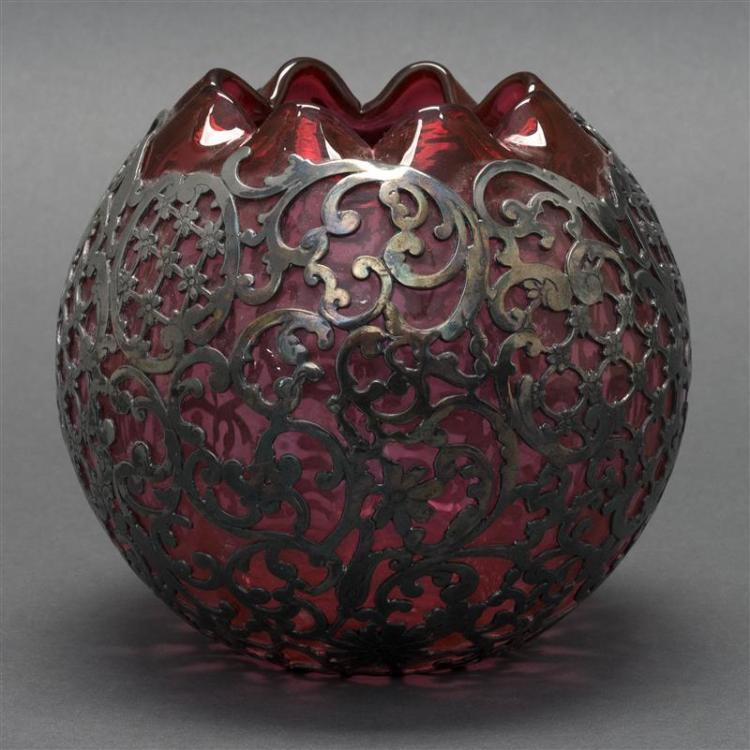 SILVER-CASED GLASS ROSE JAR In cranberry with scrolled flower and lattice design. Height 5.25