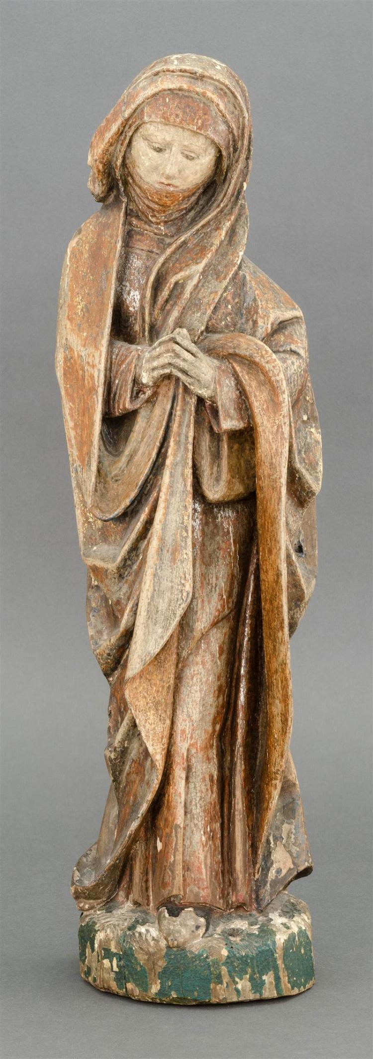 CARVED WOOD FIGURE OF ST. ANNE In standing position with red robes highlighted in silver and gold. Height 21.25