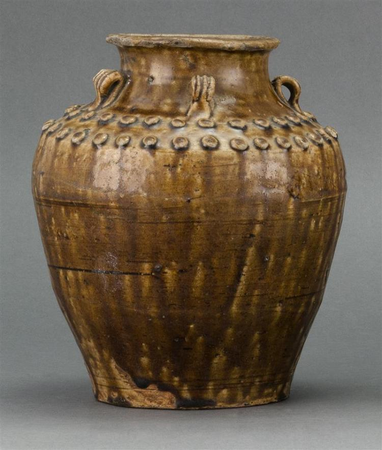 BROWN GLAZE POTTERY STORAGE JAR In ovoid form with three loop handles and raised bosses at shoulder. Height 8.5