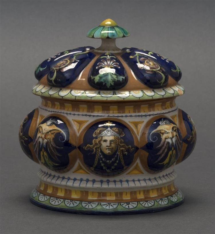 ITALIAN FAÏENCE COVERED JAR With raised portrait designs. Height 5.5