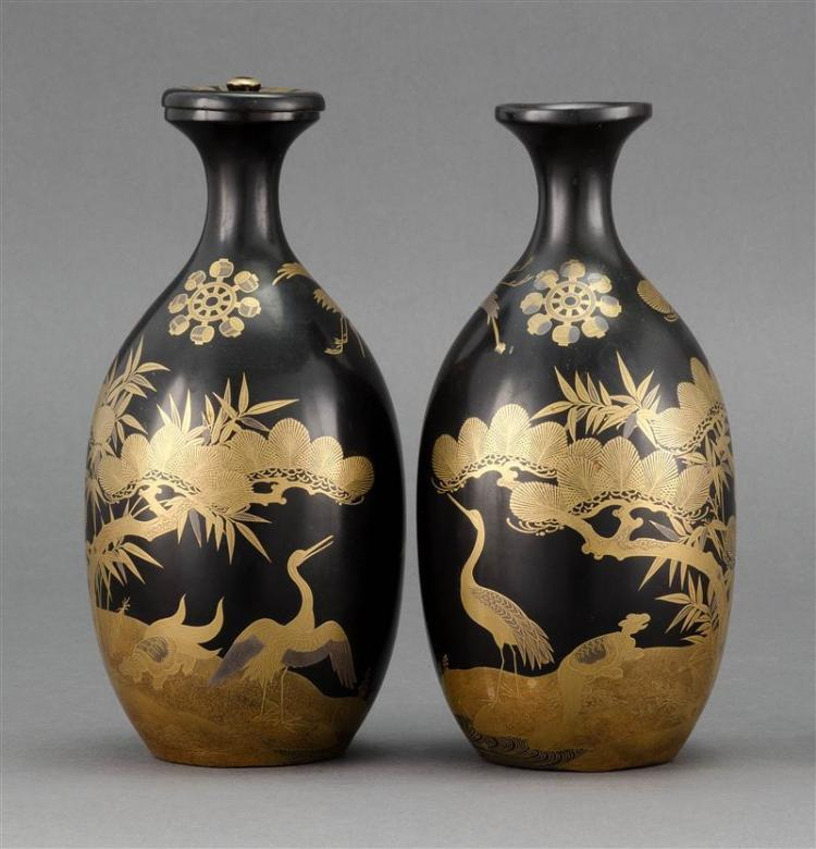 PAIR OF BLACK AND GOLD LACQUER SAKE BOTTLES With minogame and crane design. Heights 8.2