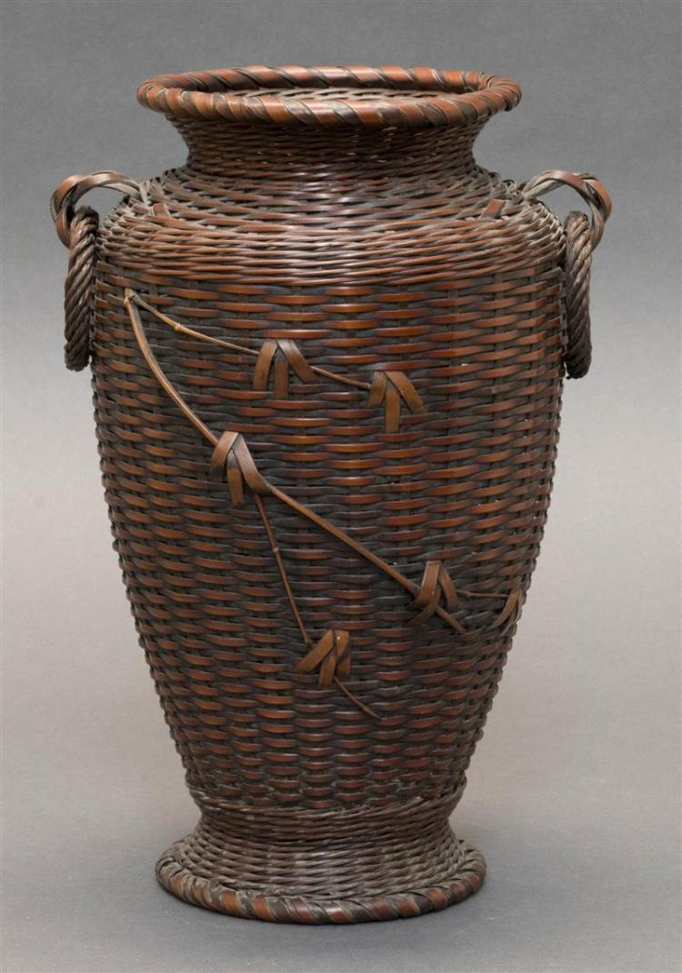 SPLINT BAMBOO IKEBANA BASKET In temple jar form with two loose ring handles and bamboo imbrication. Height 11