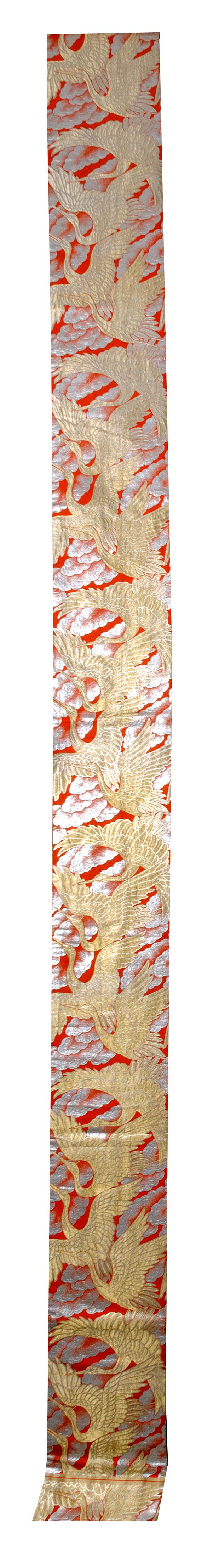 SILK BROCADE OBI In design of golden cranes on a silver and orange cloud-filled sky.