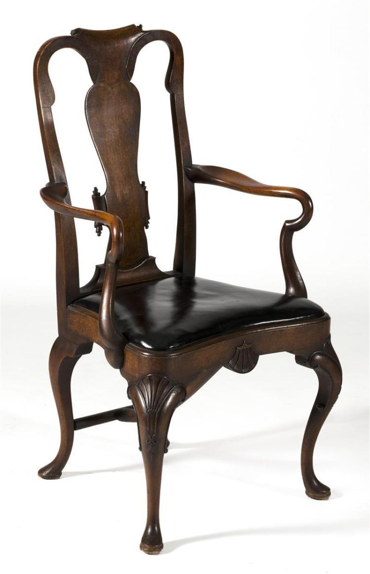QUEEN ANNE-STYLE ARMCHAIR Early 20th Century With cabriole legs, shell-carved knees, splat back, and slip seat.