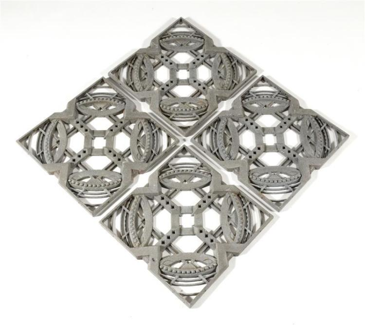 FOUR ART DECO CAST ALUMINUM WINDOW GRATES With openwork wheel-like design. Each 18
