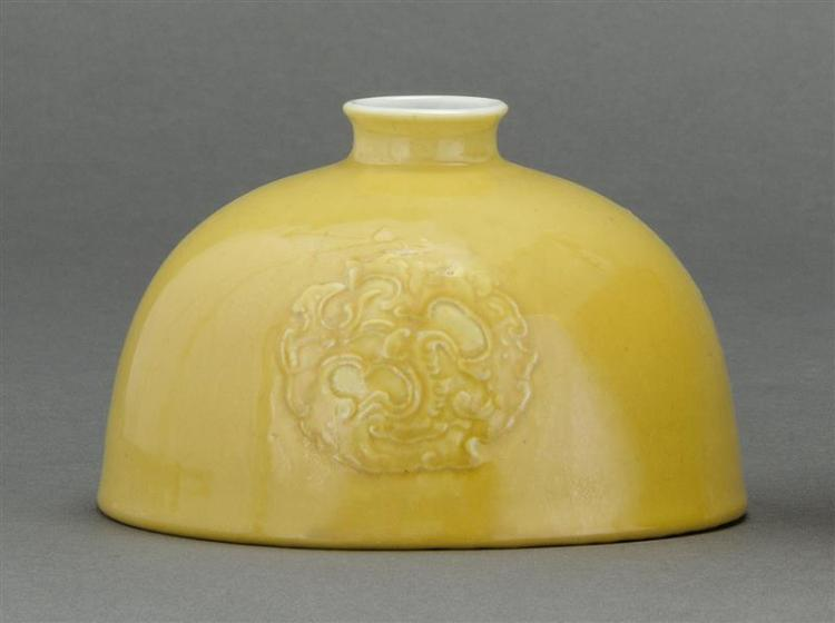 IMPERIAL YELLOW GLAZE PORCELAIN WRITER'S COUPE In beehive form with raised dragon rondels. Six-character Kangxi mark on base. Diamet..