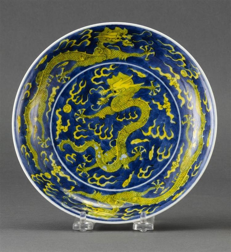 BLUE AND YELLOW PORCELAIN PLATE With five-claw dragon design on a blue cloud-filled ground. Six-character Guangxu mark on base. Diam...