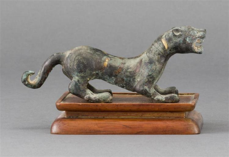 INLAID BRONZE FIGURE In the form of a tiger with gold striping and spots. Length 6.7