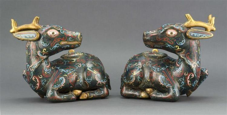 PAIR OF CLOISONNÉ ENAMEL BOXES In the form of reclining deer. With stylized design on a green ground. Lengths 12