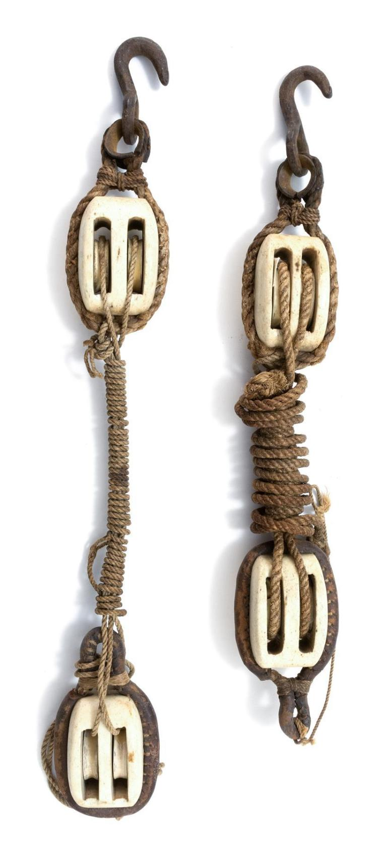 TWO PAIRS OF WHALEBONE DOUBLE-BLOCKS With original iron hooks and grommets, and ropework attachments. One with leather-covered rope....