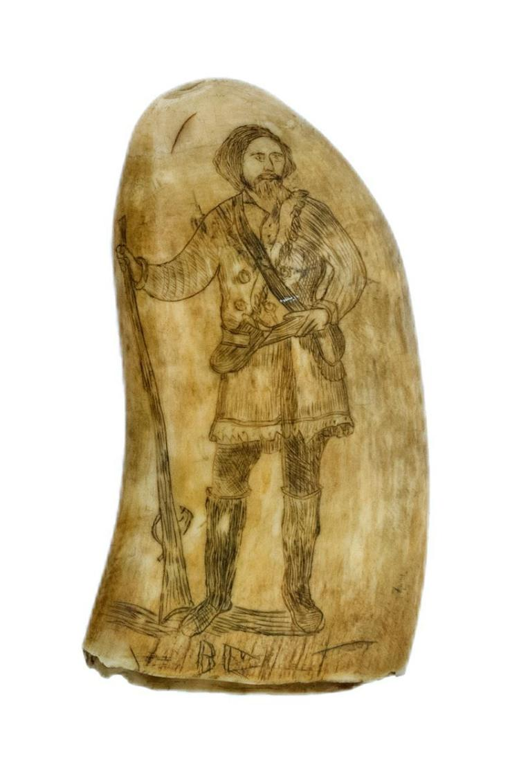 SCRIMSHAW WHALE'S TOOTH Obverse depicts a woman dressed in a long robe holding a torch in one hand and a sheaf of wheat in the other..