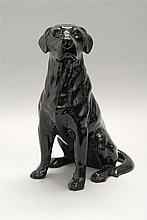 BESWICK POTTERY FIGURE A black labrador dog in seated position. Height 13.25