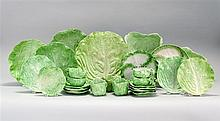 TWENTY-EIGHT PIECE COLLECTION OF LETTUCE LEAF-FORM CERAMICS A serving plate, length 12.5