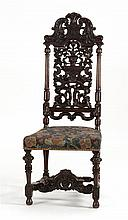 ORNATELY CARVED WALNUT SIDE CHAIR In Carolinian style with leaves, flowers, and plumes.