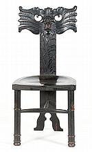 THREE-FOOTED OAK SIDE CHAIR With carved grotesque mask back.