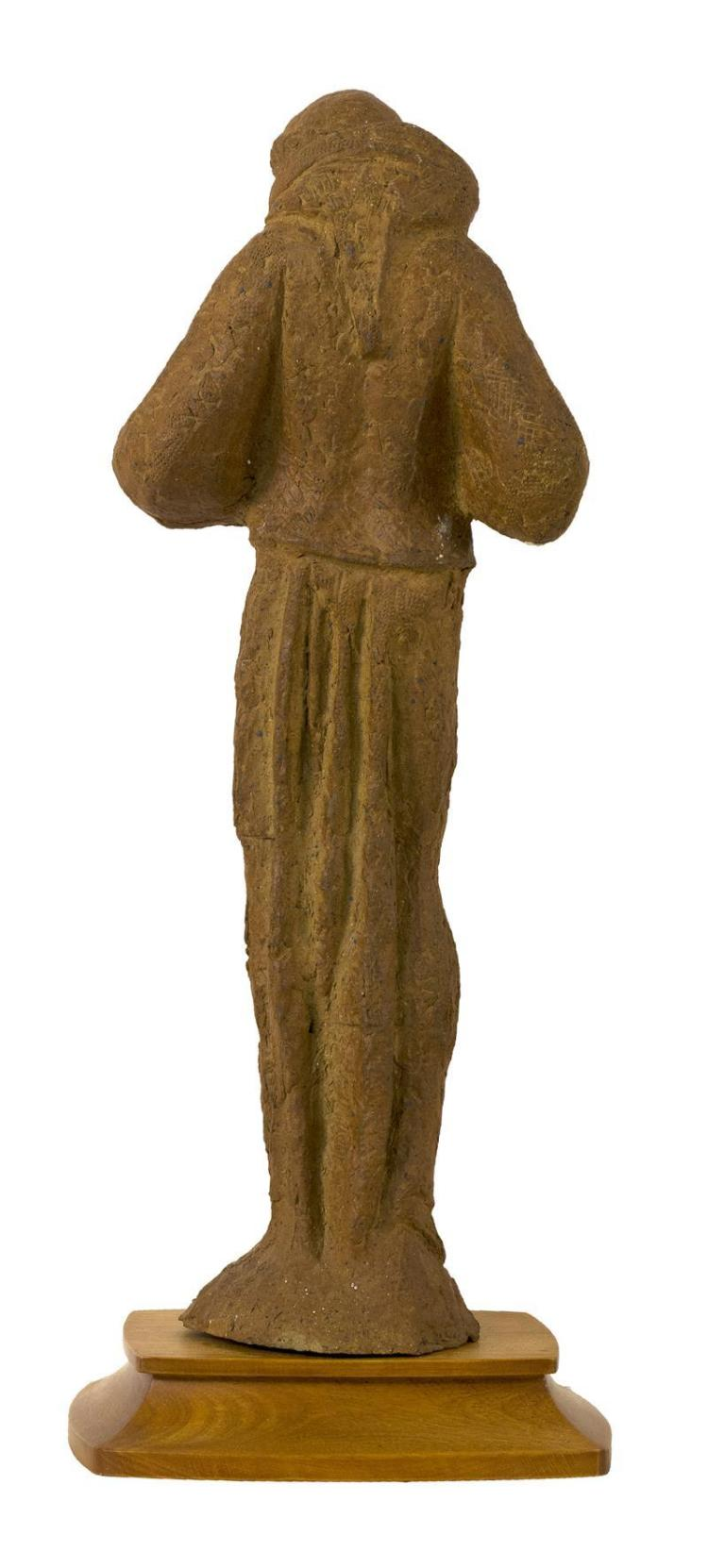 ARNOLD GEISSBUHLER, Massachusetts, 1897-1993, Saint Francis holding a bird., Red clay sculpture, height 24.75