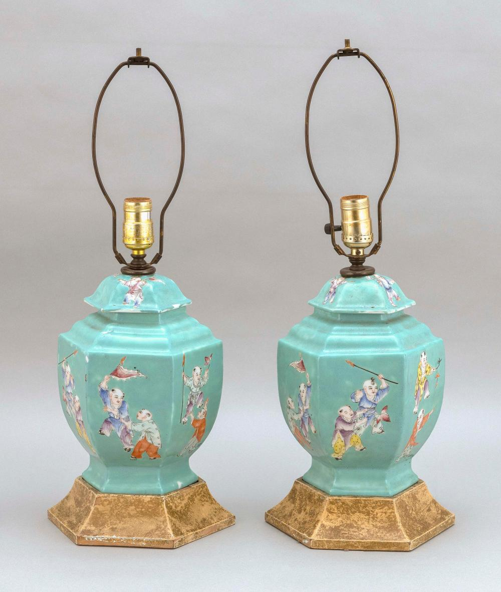 """PAIR OF CHINESE FAMILLE ROSE PORCELAIN COVERED JARS 19th Century Heights 10"""". Mounted as table lamps with flared wood bases. Total heights 22""""."""