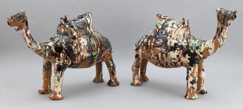 PAIR OF CHINESE SANCAI POTTERY CAPARISONED CAMEL-FORM WINE JARS Late 19th Century Heights 15