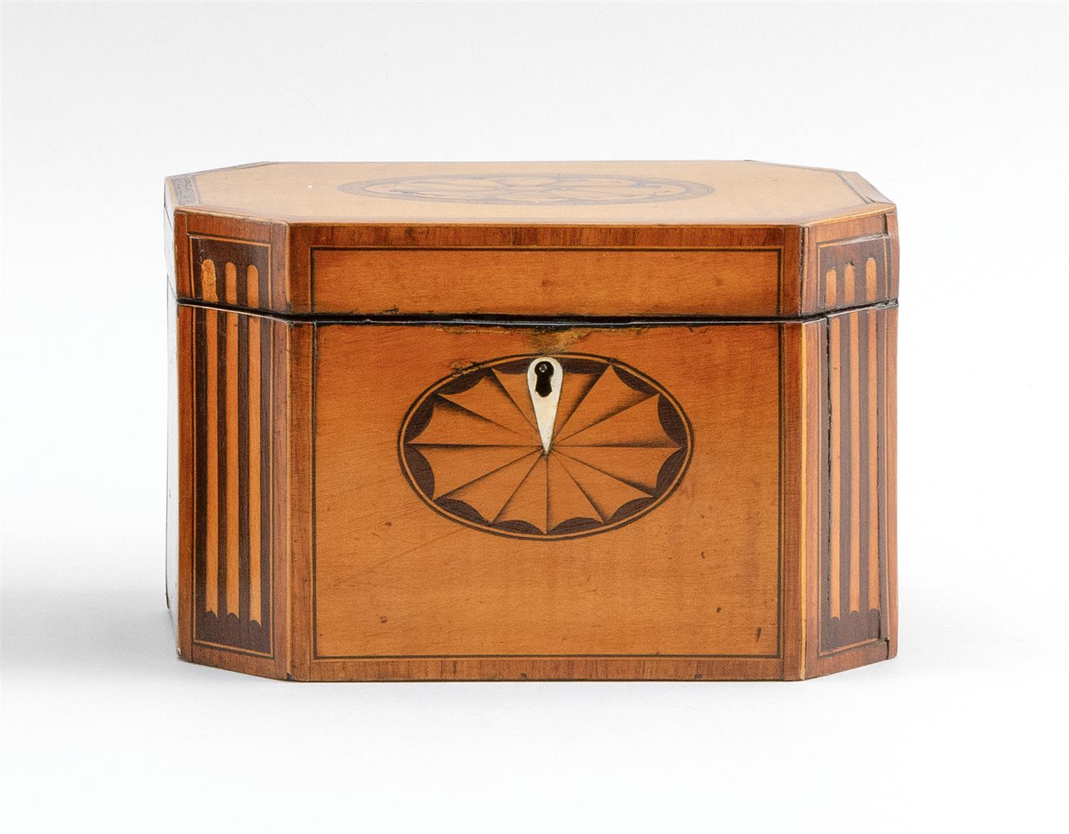 "ENGLISH SATINWOOD AND FRUITWOOD INLAID TEA CADDY Octagonal, with lift top and fitted interior. Height 4.75"". Width 7.5"". Depth 4.75""."