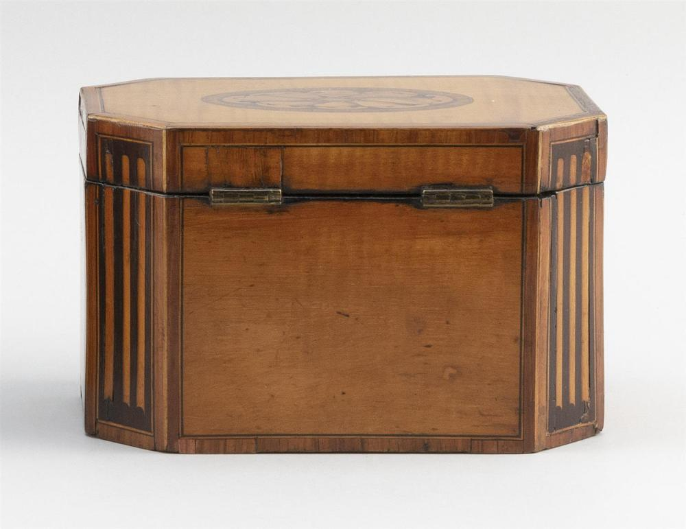 ENGLISH SATINWOOD AND FRUITWOOD INLAID TEA CADDY Octagonal, with lift top and fitted interior. Height 4.75