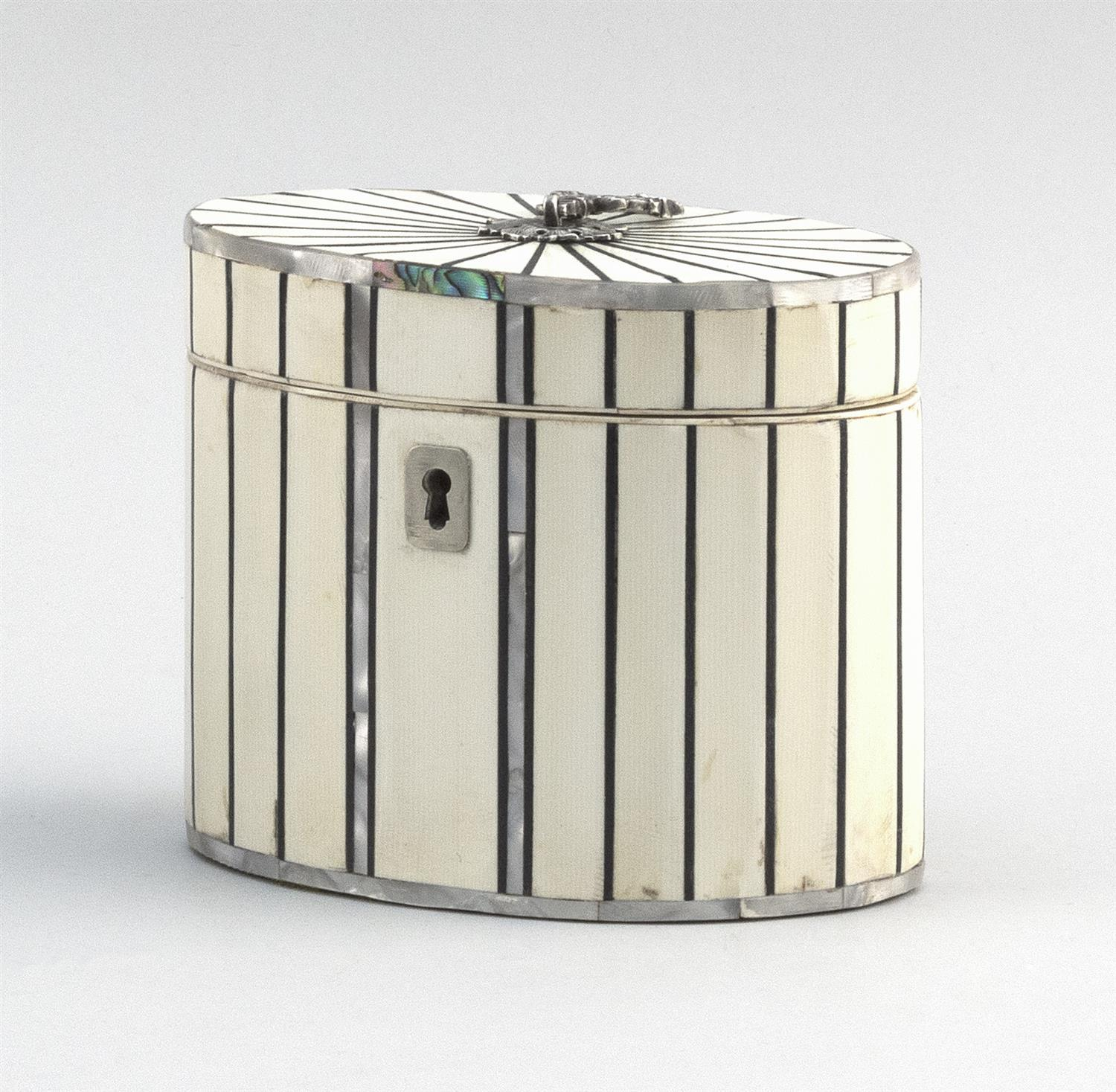 """ENGLISH BONE, ABALONE AND SILVER PLATED OVAL TEA CADDY With lift top and fitted interior. Height 4.25"""". Length 5"""". Width 3.5""""."""