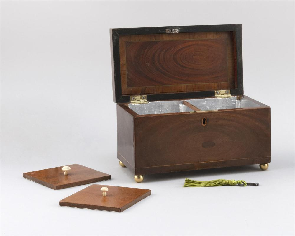 ENGLISH WALNUT TEA CADDY Stepped lift top with brass bail handle. Fitted interior. Brass ball feet. Height 6.5