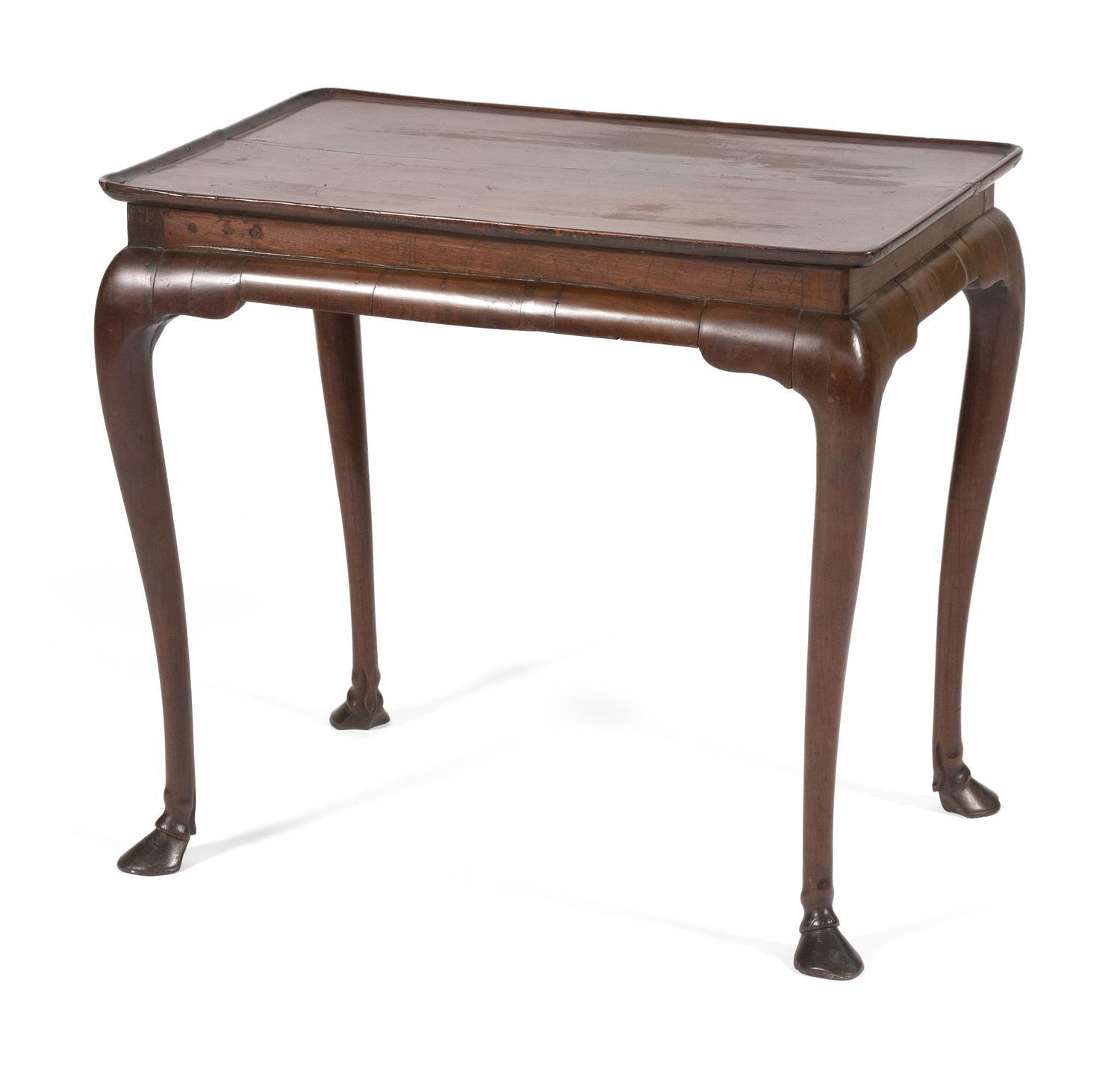 """IRISH QUEEN ANNE TRAY-TOP TEA TABLE In mahogany, with molded-edge top and cabriole legs ending in hooved feet. Height 26"""". Top 29"""" x..."""