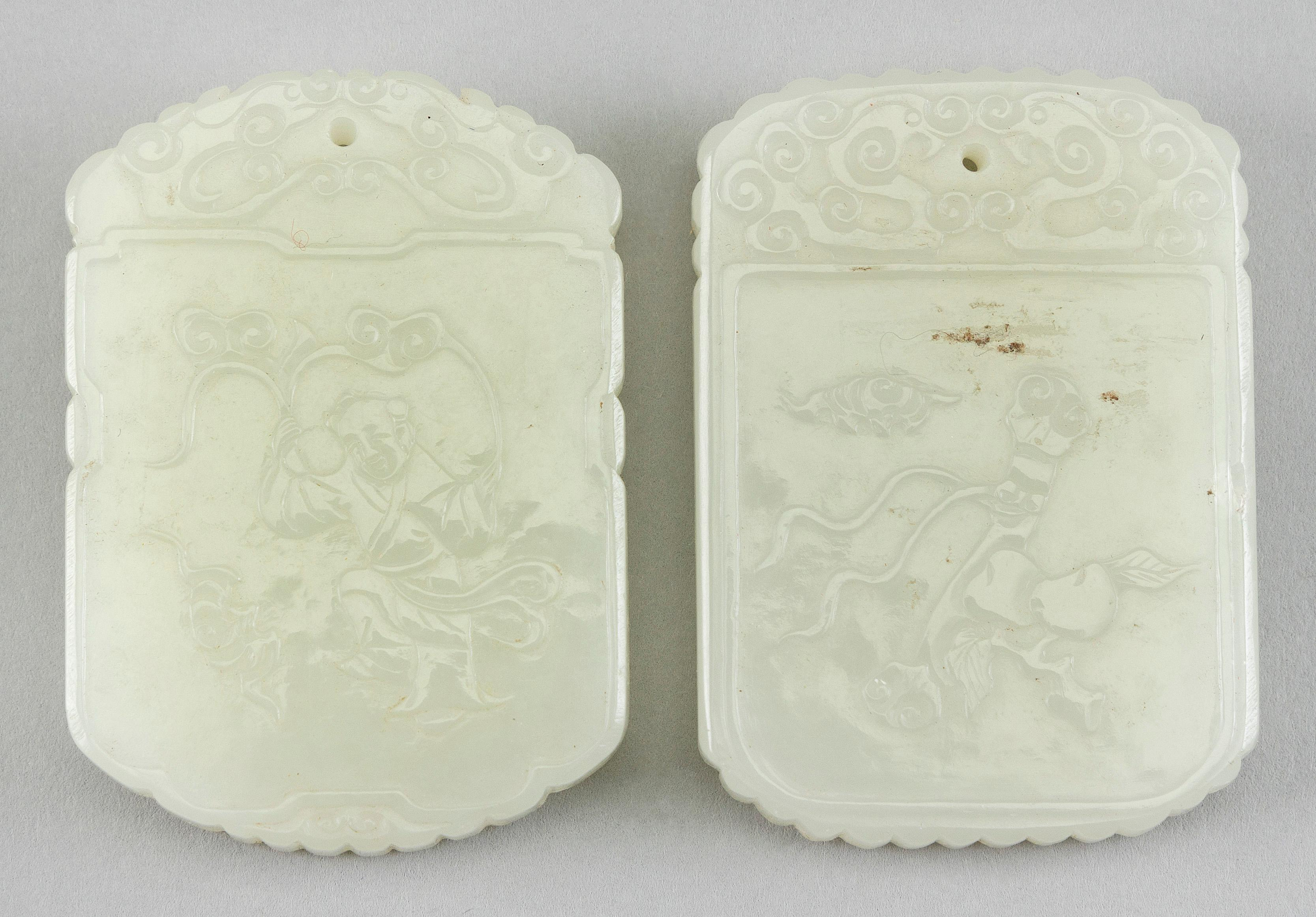 """TWO CHINESE CARVED JADE PENDANTS 20th Century Both 2"""" x 1.25""""."""