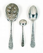 THREE STERLING SILVER SERVING ITEMS A Kirk & Sons sauce ladle and a Gorham serving spoon, both with repoussé handles, and a Stieff s...