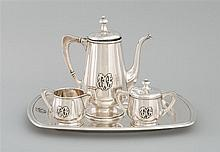 TOWLE STERLING SILVER FOUR-PIECE COFFEE SERVICE With design of N.P. Lackritz. Art Nouveau-style raised monogram. Consists of a coffe...