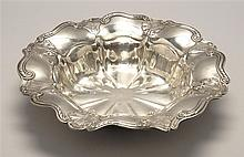 STERLING SILVER CENTERPIECE BOWL BY GORHAM MFG. CO. In circular form with scroll and floral applied decoration. Diameter 12.25