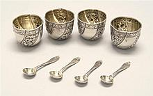SET OF FOUR ENGLISH SILVER OPEN SALTS Together with matching salt spoons. Open salts in circular form with repoussé floral decoratio...